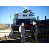 Edward Acton shows Galen Milne around Macduff Harbour May 2011